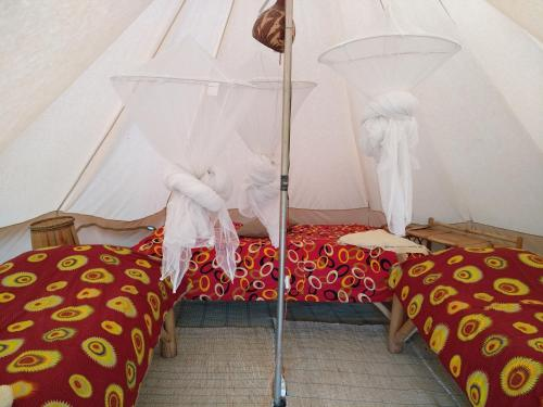 A bed or beds in a room at INZU Lodge