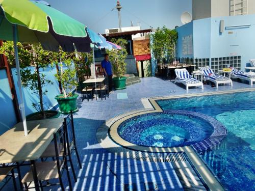 The swimming pool at or near Grand Mayfair Hotel