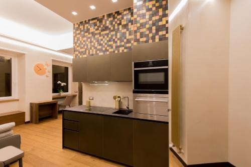 A kitchen or kitchenette at Civico Cinque Home Luxury Apartment