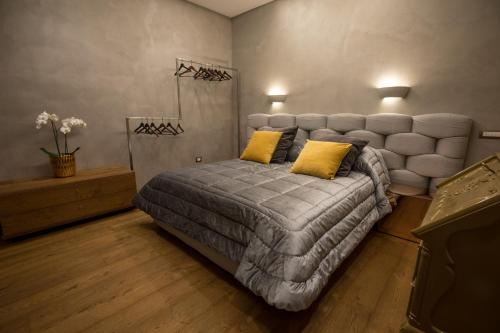 A bed or beds in a room at Civico Cinque Home Luxury Apartment