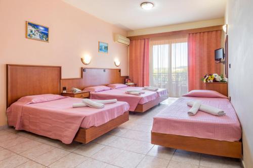 En eller flere senger på et rom på Alea Hotel Apartments