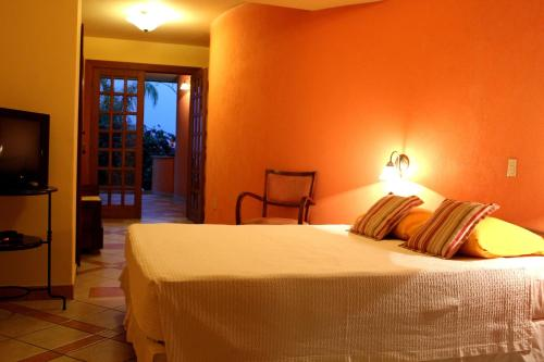 A bed or beds in a room at Pousada do Pilar