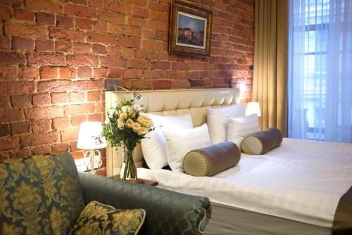 Cama o camas de una habitación en Galunov Hotel