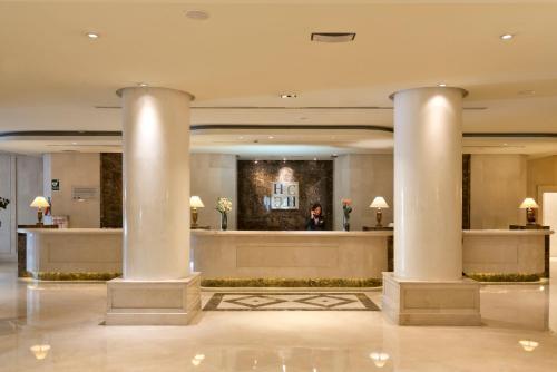 The lobby or reception area at Hotel Sevilla Center
