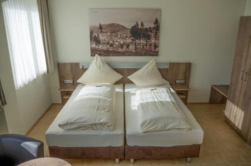 Ein Bett oder Betten in einem Zimmer der Unterkunft Zeitlers Hotel & Apartments