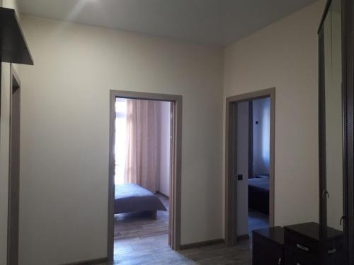 Телевизор и/или развлекательный центр в Апартаменты Аибга