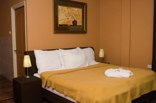 A bed or beds in a room at Sheva Hotel