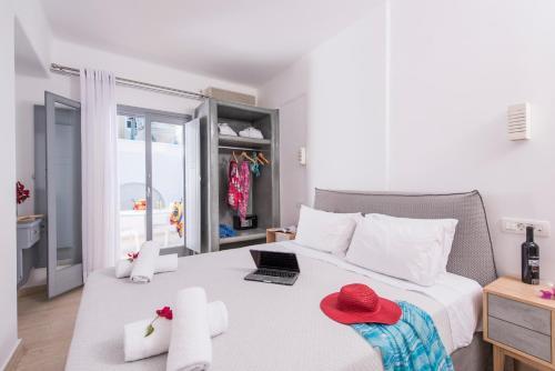 Letto o letti in una camera di Blue Waves Suites & Apartments