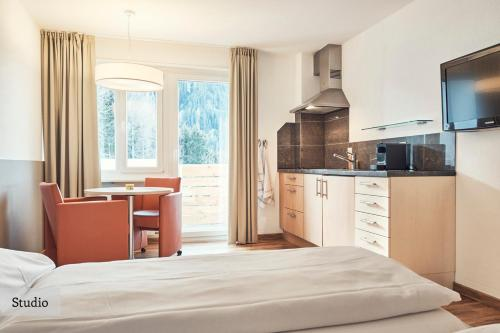 A kitchen or kitchenette at Serviced Apartments by Solaria