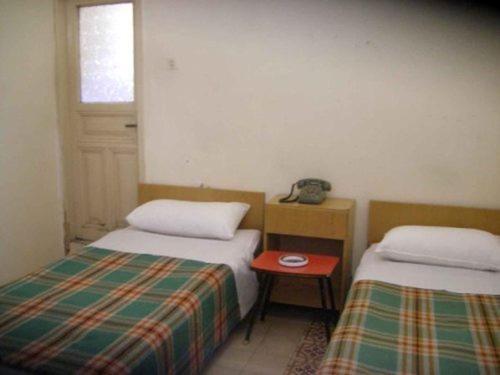 マンスール ホテルにあるベッド