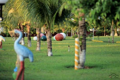 Um jardim em Hotel Tropical Garden