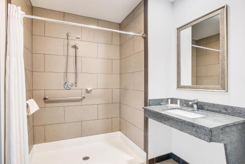 A bathroom at Days Inn by Wyndham Evans Mills/Fort Drum