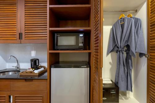 A kitchen or kitchenette at Sunwing Bangtao Beach - SHA Plus