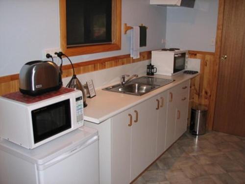A kitchen or kitchenette at Derwent Bridge Chalets & Studios