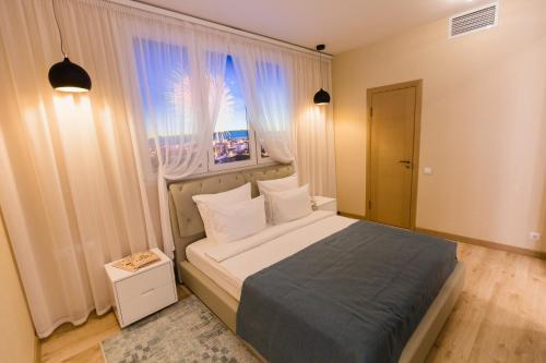 Кровать или кровати в номере Отель Воробьевы Горы