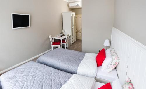 Кровать или кровати в номере Шале Де Прованс