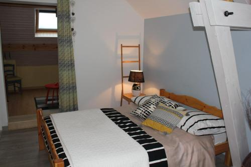 A bed or beds in a room at L'Etape