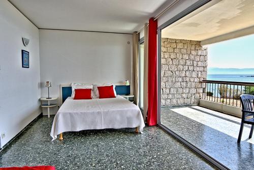 Un ou plusieurs lits dans un hébergement de l'établissement Hotel la Parata