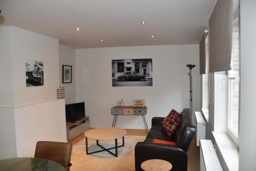 A seating area at Duplex Appartment Bruges Centre