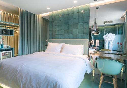 A bed or beds in a room at WC by The Beautique Hotels