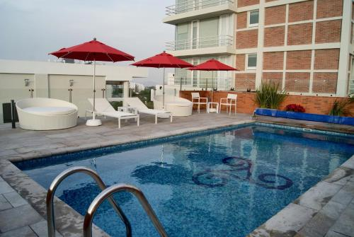 The swimming pool at or near Hotel Velvet Plaza