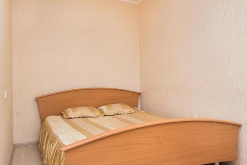 Кровать или кровати в номере Александрия на Сиреневом Бульваре