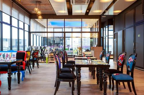A restaurant or other place to eat at Hotel Clover Asoke