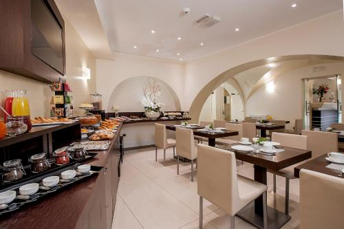A restaurant or other place to eat at Demetra Hotel