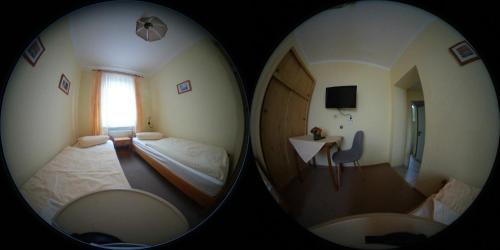 Ein Bett oder Betten in einem Zimmer der Unterkunft Gaststätte & Pension Zur Heimat
