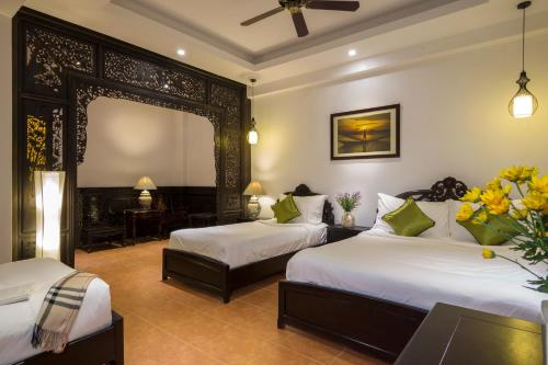 A bed or beds in a room at Acacia Heritage Hotel
