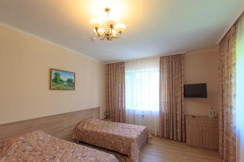 Кровать или кровати в номере Санаторий Молния
