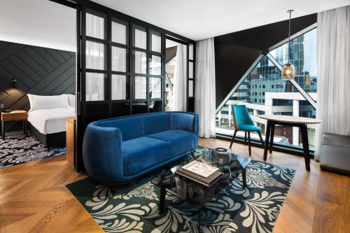 A seating area at West Hotel Sydney, Curio Collection by Hilton
