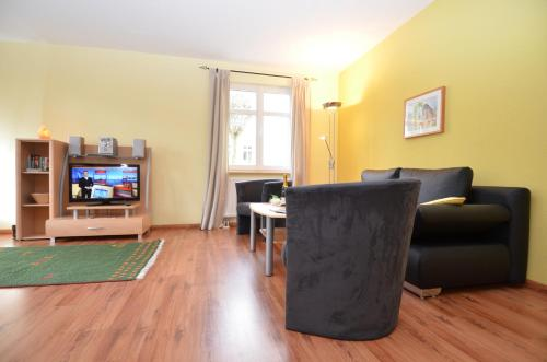 A television and/or entertainment center at Villa Seerose - Appartement 15