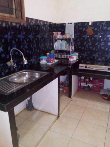 A kitchen or kitchenette at Azalea Homestay