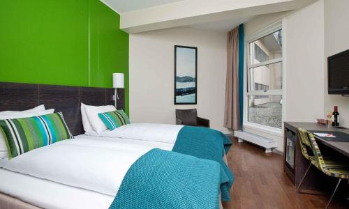 A bed or beds in a room at Thon Hotel Halden