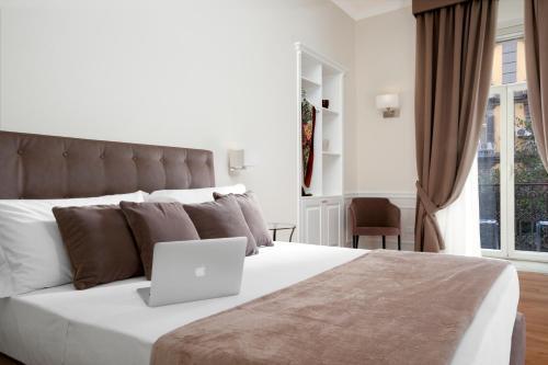 Letto o letti in una camera di La Fontanina Suites