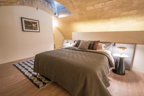 Un ou plusieurs lits dans un hébergement de l'établissement Cugo Gran Macina Grand Harbour