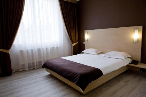 A bed or beds in a room at Bed & Breakfast Olsi