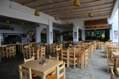 A restaurant or other place to eat at Paradise Beach Resort