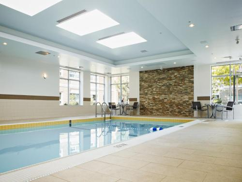 The swimming pool at or near TownePlace Suites by Marriott Mississauga-Airport Corporate Centre