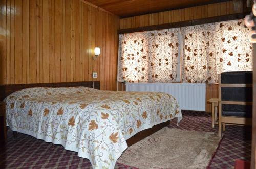 A bed or beds in a room at Hotel Affarwat