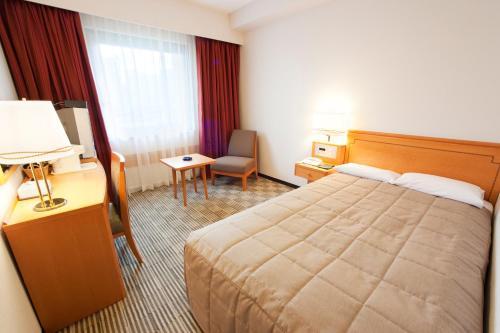 Tempat tidur dalam kamar di Navios Yokohama