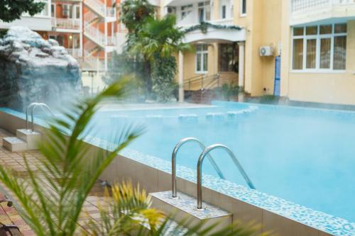 Бассейн в Отель Грейс Кипарис или поблизости