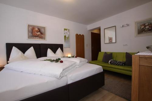 A bed or beds in a room at Pension Garni Gerhard