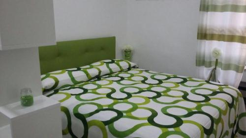 A bed or beds in a room at Salerno nel cuore suite