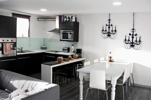A cozinha ou cozinha compacta de My Hostel