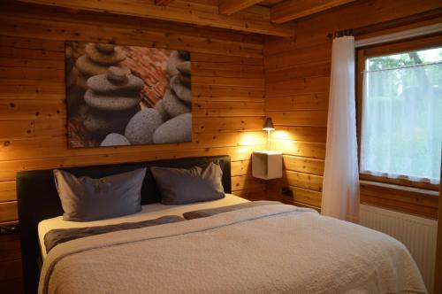 Ein Bett oder Betten in einem Zimmer der Unterkunft Family