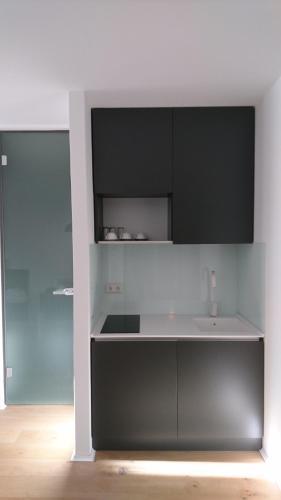 Küche/Küchenzeile in der Unterkunft HAUS 7 - Boardinghouse