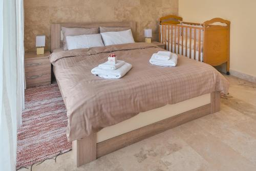 A bed or beds in a room at Apartments Residence Portofino