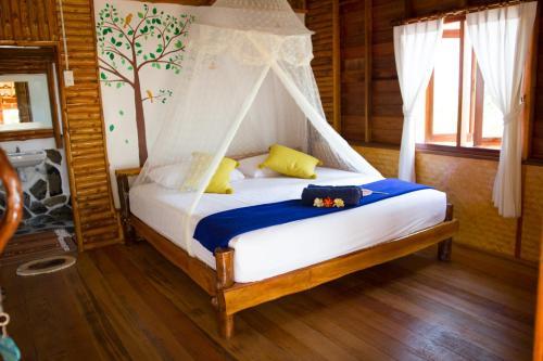 Ein Bett oder Betten in einem Zimmer der Unterkunft Angthong Beach Resort, Koh Phaluai